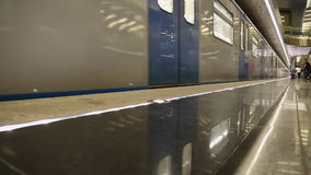 Modern silver blue metro train moving. Beautiful reflections underground train Moscow Russia stock footage