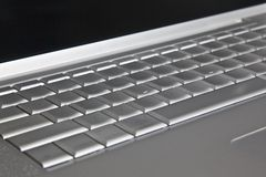 Modern silver laptop keyboard Royalty Free Stock Images
