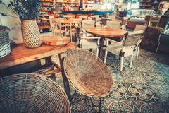 Modern simple cafe interior with wooden furniture Royalty Free Stock Photo