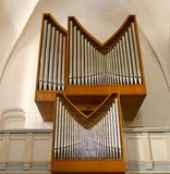 Modern, simple Church Organ Set in a Wooden Frame. Church Organ Set in a Wooden Frame royalty free stock images