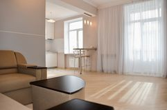 Modern, simple interior in light apartments Royalty Free Stock Image