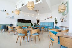 Modern and simple cafe interior. Modern and simple new beautiful cafe interior stock photos