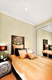 Modern single bedroom closeup focusing the wooden bed included a Royalty Free Stock Photo