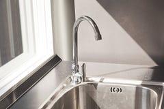 Modern sink on. Black kitchen counter Royalty Free Stock Photos