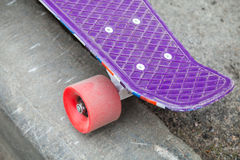 Modern skateboard stands on the curb Stock Photography