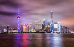 The modern skyline of Shanghai on a cloudy night Stock Photos