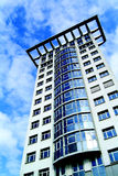 Modern skyscraper. Low angle view of modern skyscraper or high rise apartment building with blue sky and cloudscape background Royalty Free Stock Photos