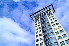 Modern skyscraper. Low angle view of modern skyscraper with blue sky and cloudscape background Royalty Free Stock Images