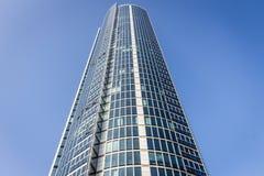 Modern skyscraper against blue skies