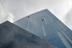 Modern skyscraper on a background of blue sky. Royalty Free Stock Images