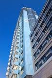 Modern skyscraper on blue sky background Stock Photo