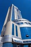 Modern skyscraper on blue sky background Royalty Free Stock Photography
