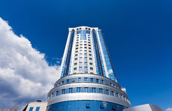 Modern skyscraper on blue sky background Stock Photography