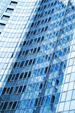 Modern skyscraper blue wall with reflections Stock Photos