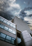 Modern skyscraper business building stormy sky background Royalty Free Stock Photo