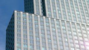 Modern skyscraper facade. Glass windows on exterior facade of modern skyscraper building, Montreal, Quebec, Canada Royalty Free Stock Photo