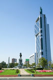 Modern skyscraper and statue in the center of Santiago de Chile Royalty Free Stock Photography