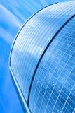 Modern skyscraper under blue sky stock image