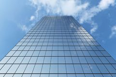 Modern skyscraper under blue sky with clouds. Low angle view of modern business skyscraper in business district in day sunlight under blue sky with clouds Royalty Free Stock Images
