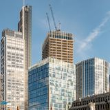 Under Construction, City of London skyscrapers. A modern skyscraper under construction in the heart of London financial district Stock Photos