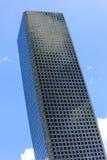 Modern skyscraper. Upward view of a modern rectangular skyscraper Stock Image