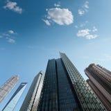 Modern skyscrapers against a blue sky Stock Photos