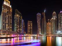 Modern skyscrapers around the harbor in Dubai Marina. In the night United Arab Emirates Stock Image