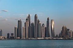 Modern skyscrapers around the harbor in Dubai Marina. In the night United Arab Emirates Stock Images