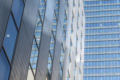 Modern skyscrapers in business building in Japan. Modern skyscrapers in business building windows blue sky reflection Stock Image
