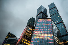 Modern skyscrapers of the business center at evening lights royalty free stock photography