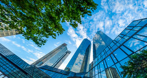 Modern skyscrapers in business district against blue sky Royalty Free Stock Image