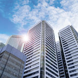 Modern Skyscrapers in Business District With Lens Flare Stock Images