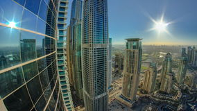 Modern skyscrapers in Dubai Marina with sun and. Reflection at sunrise timelapse fisheye. Here is the tallest residential building in the world. March 7, 2014 stock video footage