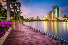 Modern skyscrapers, flowers, and palm trees along Lake Rajada at Royalty Free Stock Photography