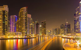 Modern skyscrapers in luxury Dubai Marina with busy canal in the evening,Dubai,United Arab Emirates Stock Photo