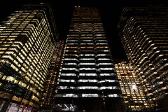 Modern skyscrapers at night. Low angle view of modern urban skyscrapers illuminated at night Royalty Free Stock Photography