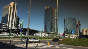 Modern skyscrapers and old tramway,Milan, ULTRA HD 4k, real time. Editorial-MILAN, ITALY - circa 2016: Unicredit skyscraper tower, UniCredit Pavilion, Bosco stock footage