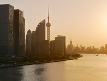 Modern skyscrapers over sunset sky, Shanghai Stock Image