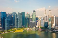 Modern Skyscrapers By River In Singapore Stock Photo