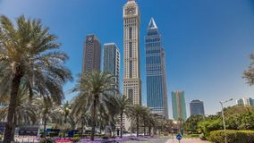 Modern skyscrapers of the skyline along the business center of Sheikh Zayed Road timelapse in Dubai, UAE. Palms on the street and traffic stock video