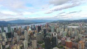 Modern skyscrapers towers architecture of Vancouver downtown financial district big famous city by water in 4k aerial stock video footage