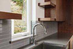 Modern sleek kitchen with brown cabinets stock images