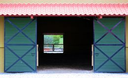 Modern sliding doors at horse stable and riding school  in barn at farm Royalty Free Stock Image