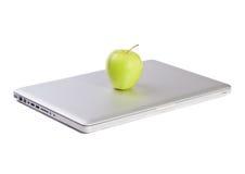 Modern slim laptop with green apple Royalty Free Stock Photo