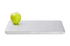 Modern slim laptop with green apple Stock Photography