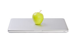 Modern slim laptop with green apple Stock Photo