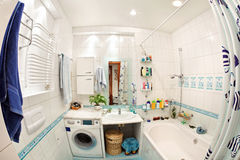 Modern small bathroom in blue colors. Wide angle fisheye view Royalty Free Stock Image