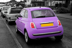 Modern small purple fiat 500 Royalty Free Stock Photography