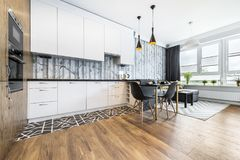 Modern small room with  kitchen. Area and wooden floor Royalty Free Stock Photo