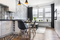 Modern small room with kitchen stock image